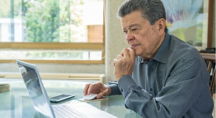 Hispanic man checks his accounts