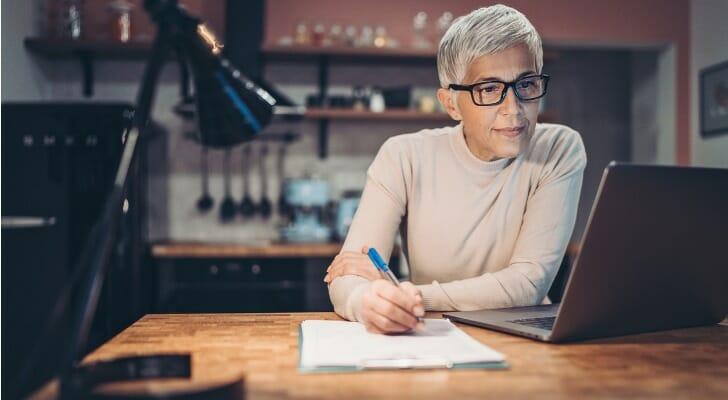 Mature woman investing