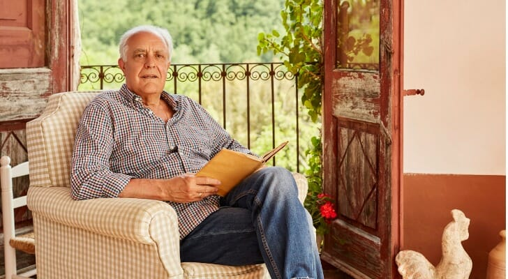 Spanish man reading an investment report
