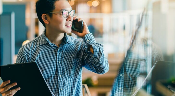 Asian man sets up a sweep account
