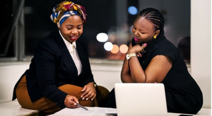 Two female investors considering the iron butterfly