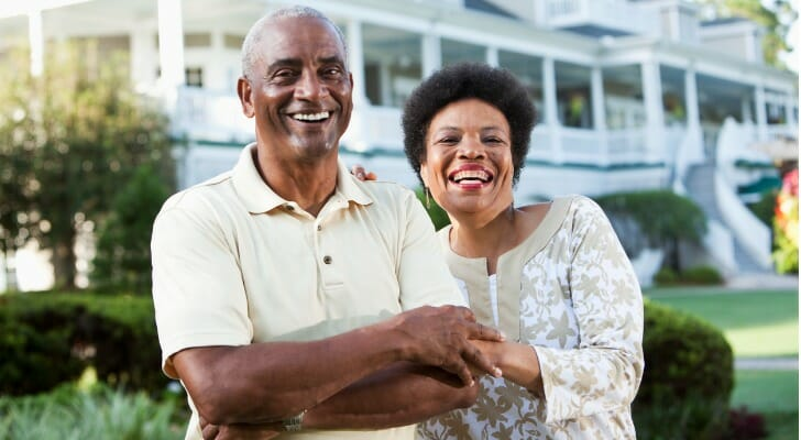 Retired couple in front of a hotel