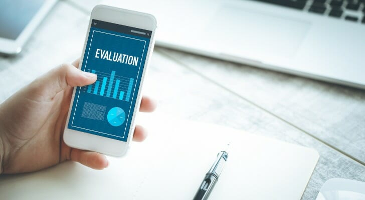"""Mobile device with """"EVALUATION"""" app"""