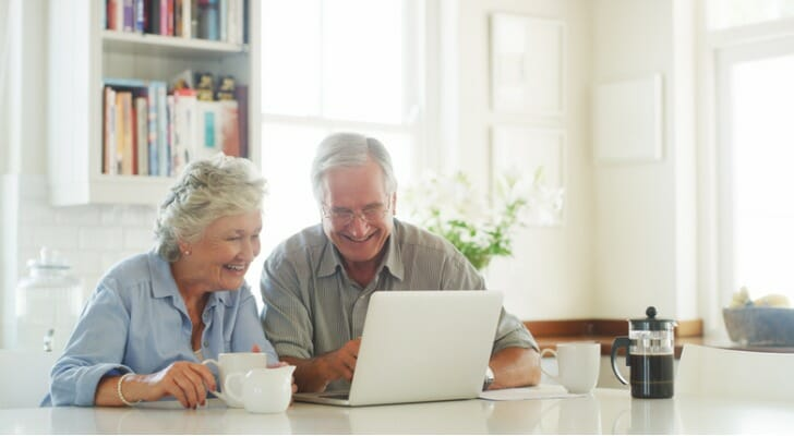 Retired couple checks their dividend payments