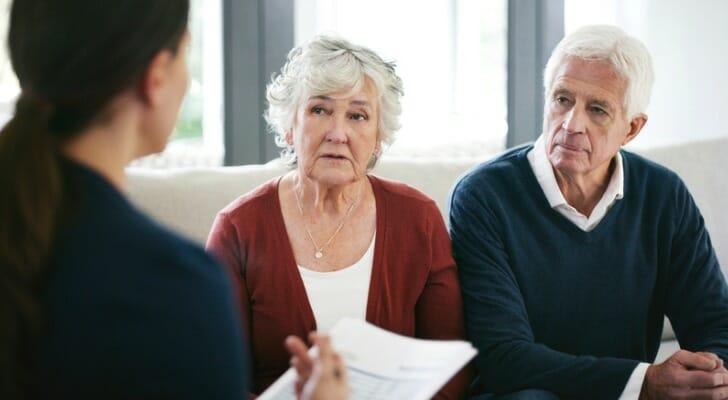 Senior couple with financial advisor