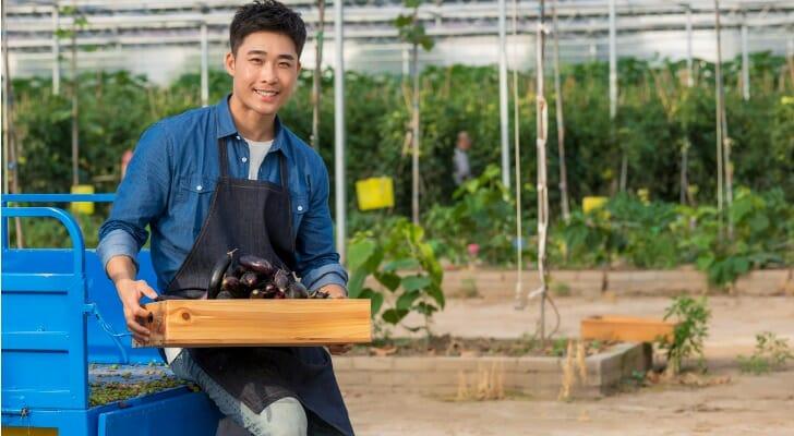 Asian-American farmer in a greenhouse