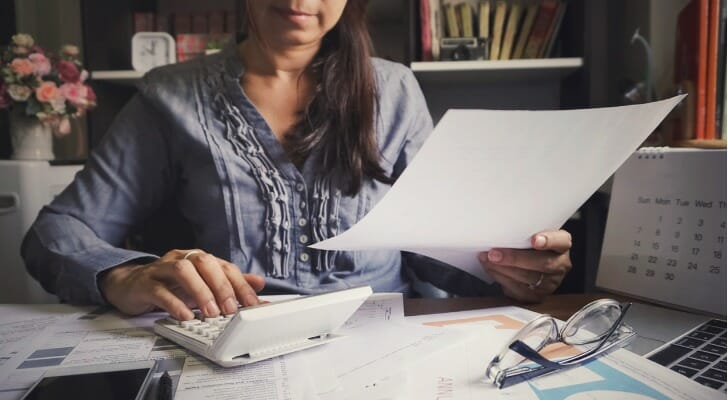 Woman filing investment tax forms