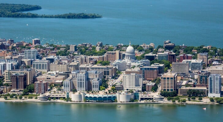 Image shows an aerial view of downtown Madison, Wisconsin. SmartAsset looked at data for all 50 U.S. state capitals to conduct the 2020 version of is study on the best state capitals for livability.