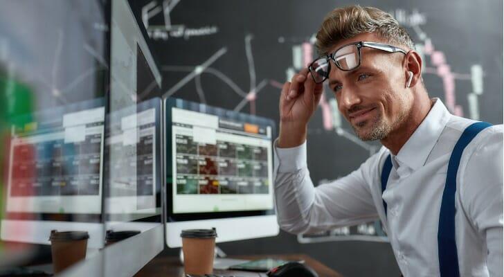 Investor monitors his stock trading simulator