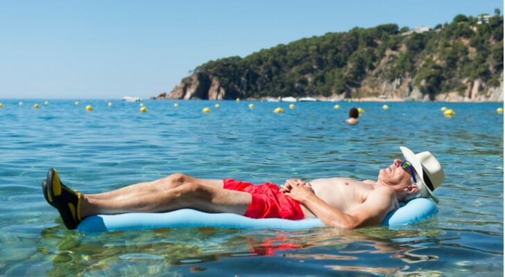 Retiree floating on an inflatable in the sea