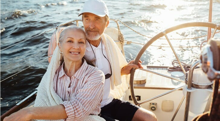 Retired couple sailing their sloop