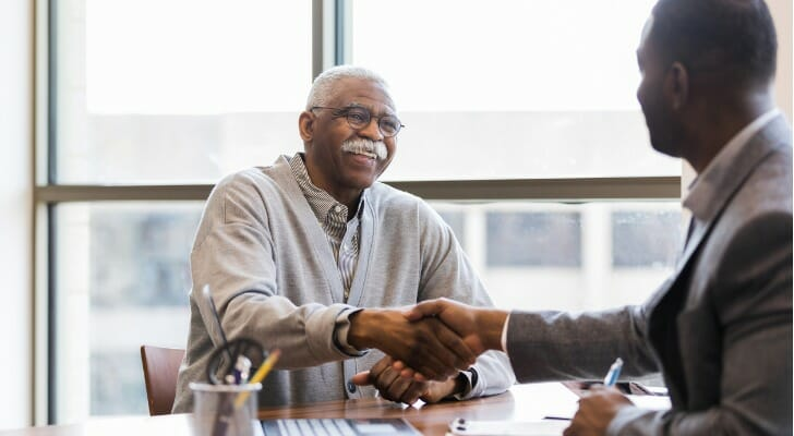 A retired man talks with his retirement advisor