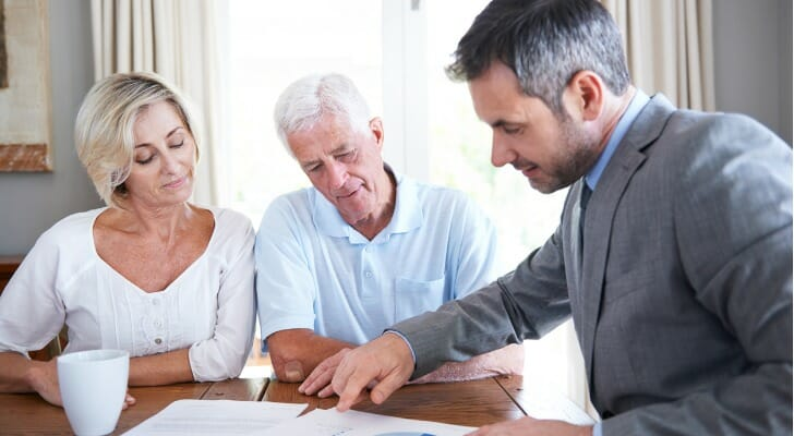 Couple consulting with their pension advisor