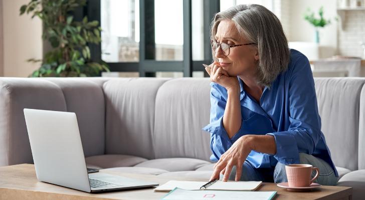 Older woman checks her brokerage account