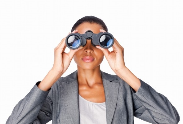woman looking through binoculars - 401(k) Rollover