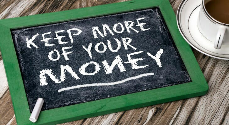 """KEEP MORE OF YOUR MONEY"" written on a chalk board"