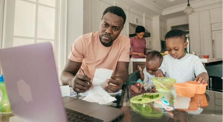Family man studying his life insurance options