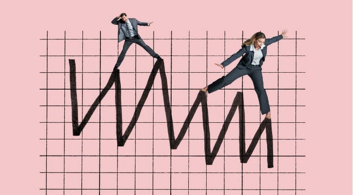 Man and woman balancing on the line of a graph