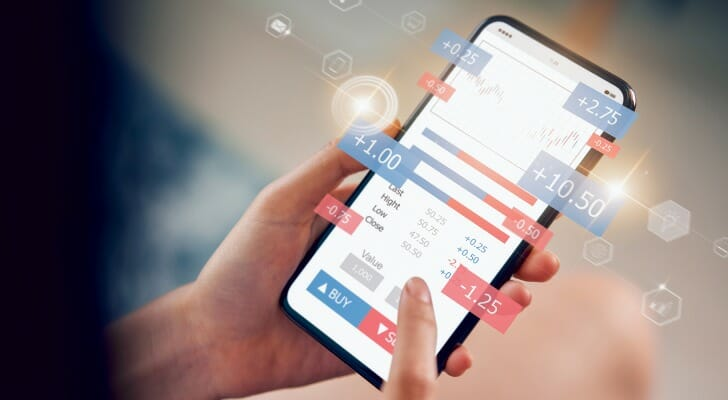 Woman using a mobile investing app