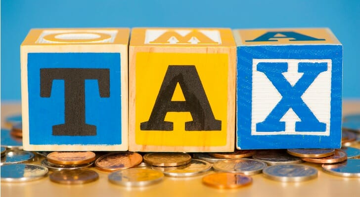 """The word """"TAX"""" spelled out with blocks"""