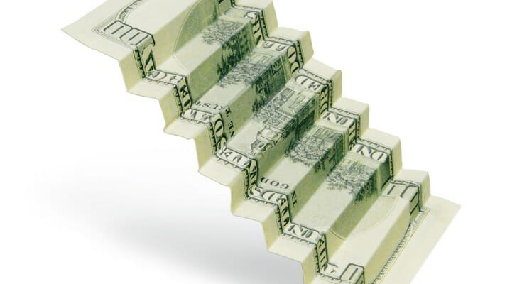 A CD ladder, depicted as a folded U.S. bill, is one way to grow your money.