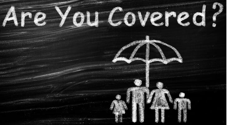 """Chalk drawing of a family under an umbrella and """"Are You Covered?"""" written on top."""