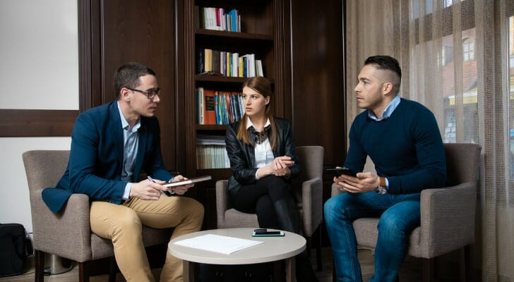 Couple speaks to an insurance agent