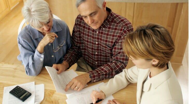 Senior couple meets with financial advisor