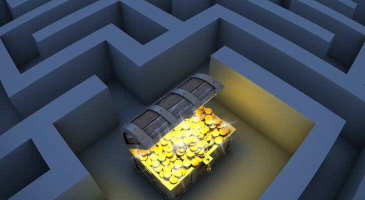 Treasure chest filled with gold in the middle of a maze.
