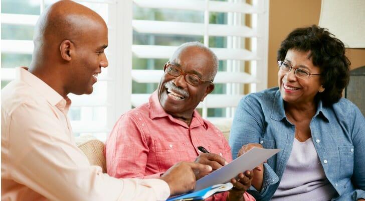 Financial advisor talks to clients