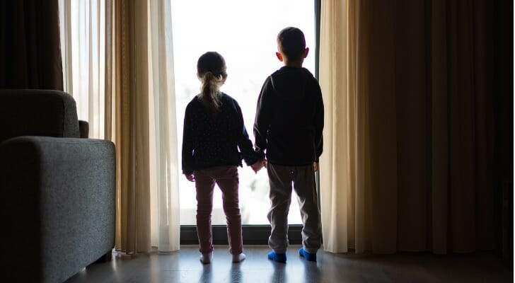 Two minors looking out a window
