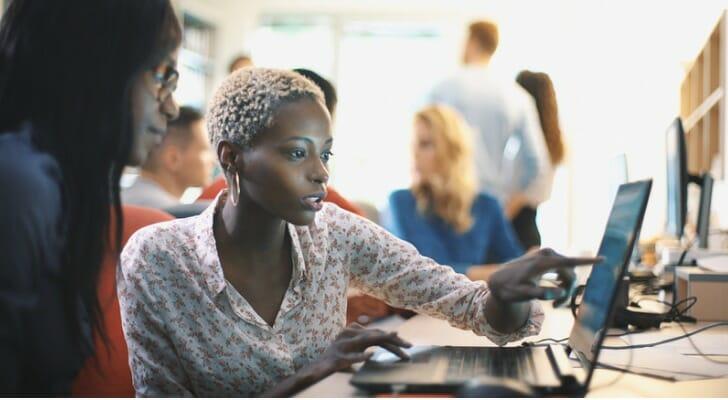 Women use their Schwab platform to check their investments