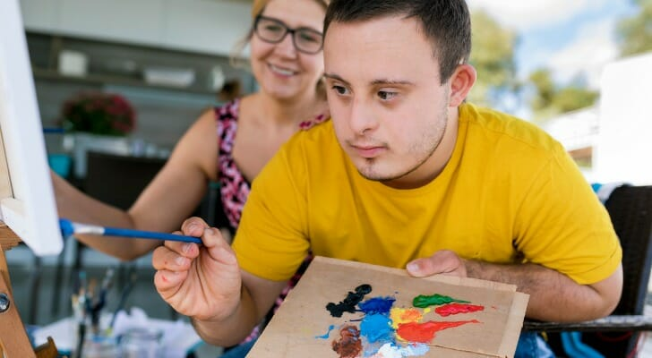 Teen with Down Syndrome painting