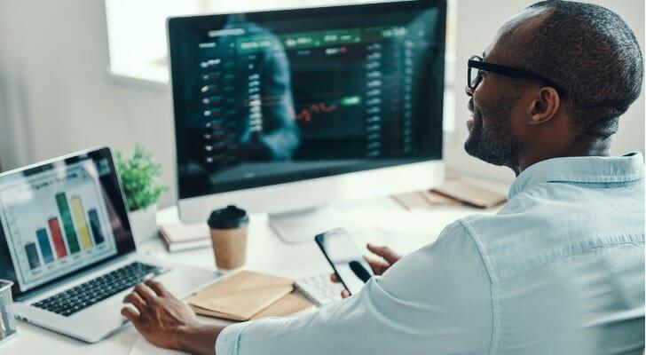 Man checks his dividend-paying stocks