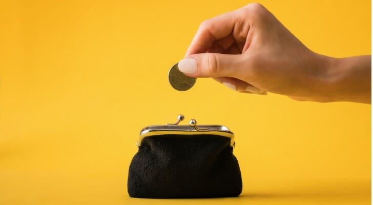 Putting a coin in a purse