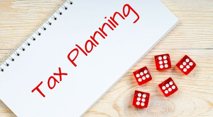 Tax planning notebook with some dice