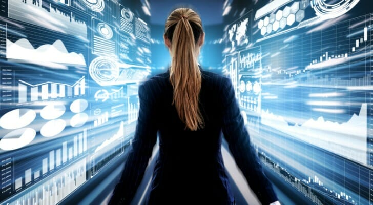 Woman standing in front of a big data chart