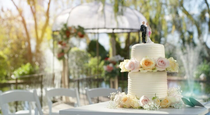 A wedding cake sits on a table at a wedding reception. SmartAsset examined 97 of the largest cities in the U.S. to find the best cities for an affordable wedding.
