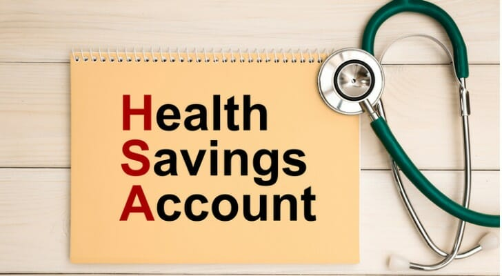 """""""Health Savings Account"""" written on notebook cover"""