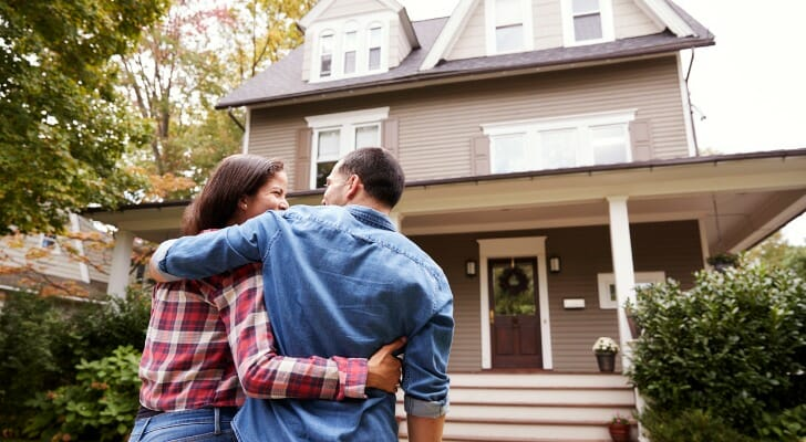 A couple walks toward their new home. SmartAsset examined housing data in hundreds of metro areas to find out which housing markets are best for growth and stability.