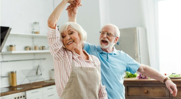 Elderly couple dancing in their kitchen