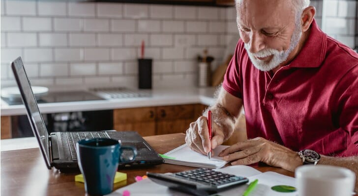 Senior man calculating his investment taxes