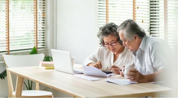 Senior Asian couple checks their investments