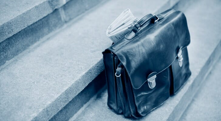 Briefcase and newspaper