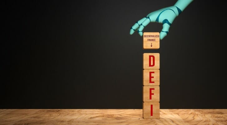 Robot and DeFi block letters