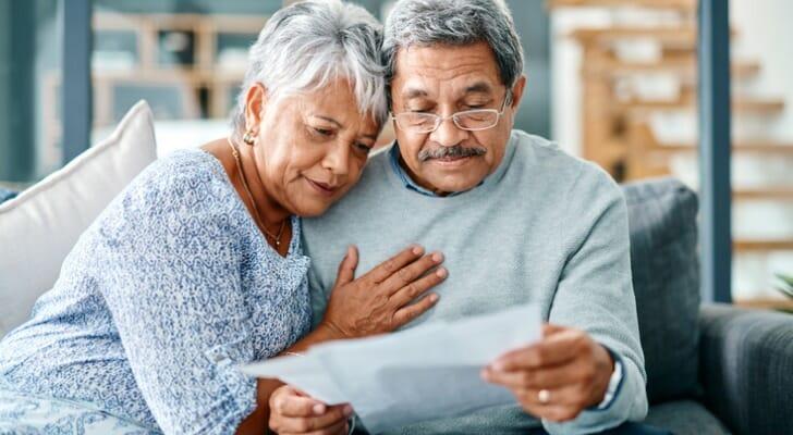 Senior couple checks their dividends