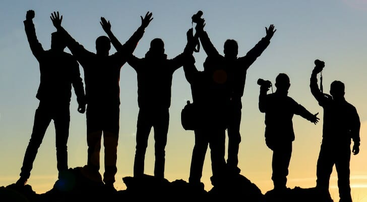 Group of people together on a summit