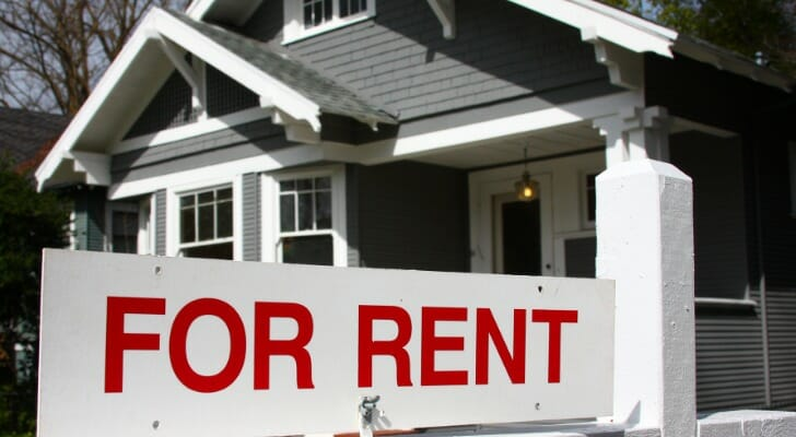 """Image shows a residential property with a """"For Rent"""" sign in front of it. SmartAsset conducted its latest study on where it pays off to buy long-term rental properties."""