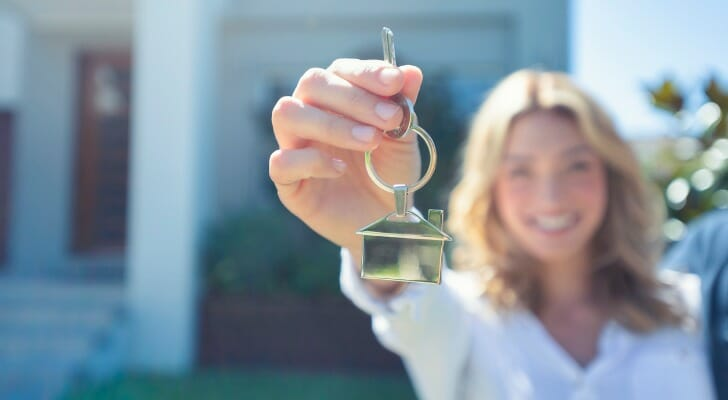 A new homeowner holds a key. SmartAsset analyzed data on various metrics to determine the cheapest states to buy a home.