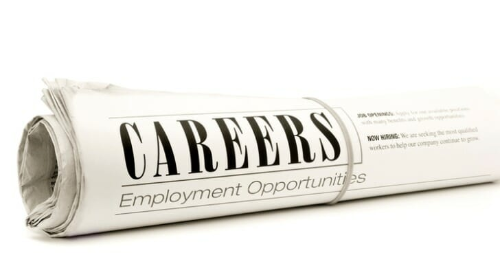 Image shows a rolled up newspaper careers section listing employment opportunities. In this study, SmartAsset finds the best U.S. metro areas for career opportunities in the COVID-19 recession.